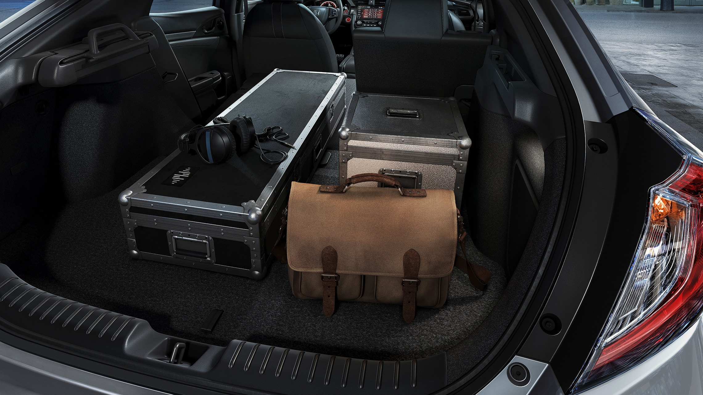 Various items loaded into cargo space of 2020 Honda Civic Sport Touring Hatchback with 60/40 split fold-down rear seatback.