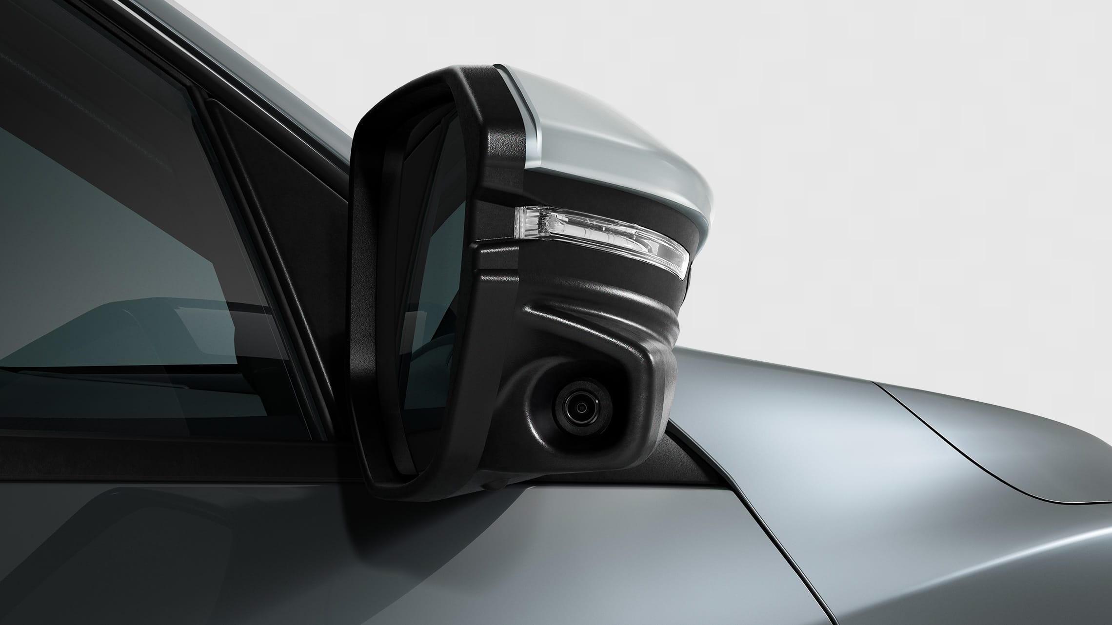 Honda LaneWatch™ camera detail on passenger's side mirror on 2020 Honda Civic Sport Touring Hatchback in Sonic Gray Pearl.